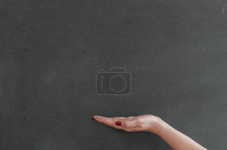 Clean chalkboard with hand and copyspace
