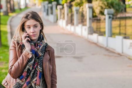 blonde talking on a cell phone.