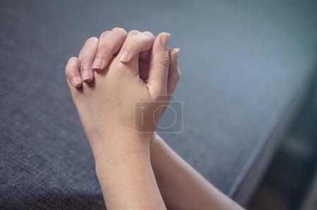 Praying woman hands.