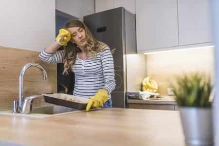Hand cleaningYoung housewife woman washing