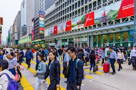 Crowded street crossing in Hong Kong