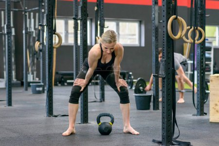 Strong fit woman making a break in a gym