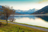 Lake Resia at sunset in the Italian Alps