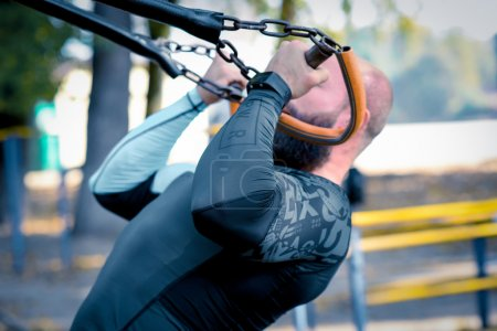 Man working out with sport equipment