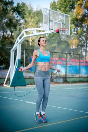 Active woman jumping rope