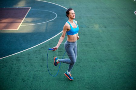 Attractive woman jumping rope