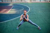 Woman doing exercises on stadium