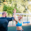 Athletic couple giving high five during workout on...