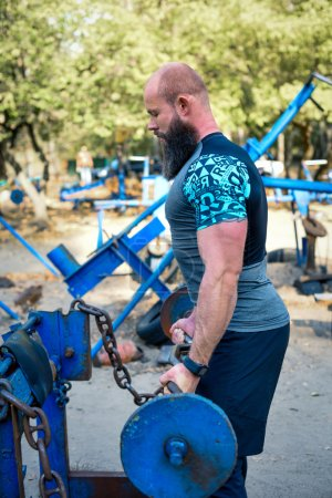 Bearded man exercising with barbell