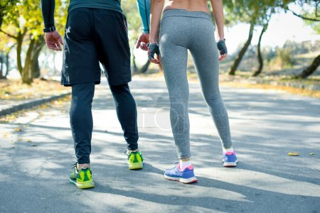 Athletic couple jogging in the park