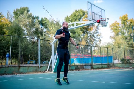 Photo for Man using skipping rope at the outdoor gym - Royalty Free Image