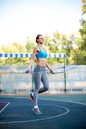Woman jumping with skipping rope