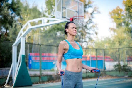 Woman working out with skipping rope