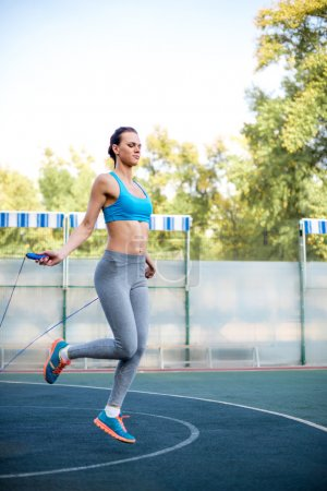 Woman using skipping rope during workout