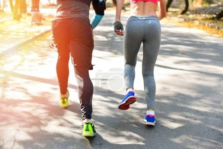 Sportive couple running