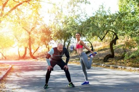 sportive couple stretching