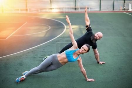 Couple exercising on stadium
