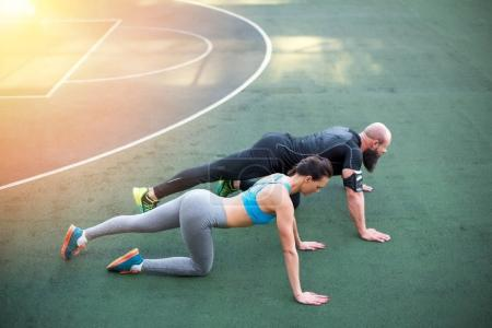 Couple exercising on stadium