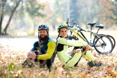 cyclists resting near bicycles