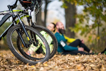 Two mountain bikes with cyclists