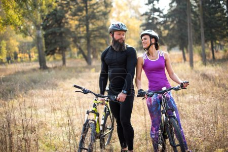 Couple cycling outdoors