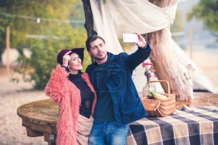 Photo for Young couple making self portrait at alfresco picnick - Royalty Free Image