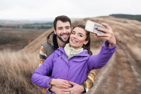 Couple taking selfie on rural path