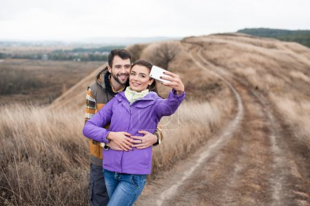 Couple taking selfie on rural path