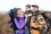 Smiling family with backpacks