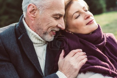 Photo for Close-up portrait of beautiful mature couple resting in autumn park - Royalty Free Image