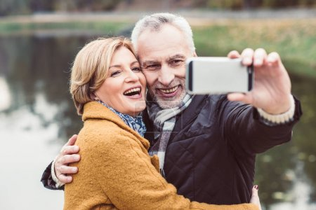 Happy mature couple taking selfie