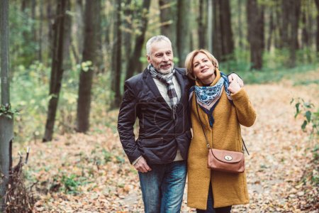 Mature couple walking in park
