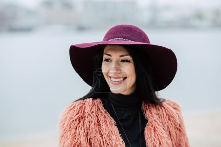 Photo for Close-up portrait of beautiful smiling young woman in violet hat outdoors - Royalty Free Image