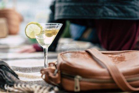 Martini glass and handbag on checkered plaid