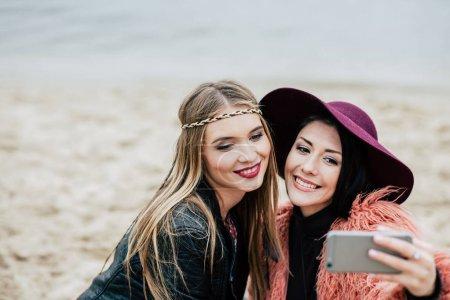 Beautiful smiling women taking selfie