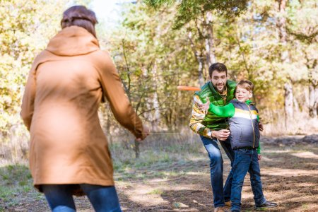 Happy family playing with frisbee