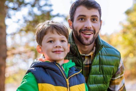 Photo for Close-up portrait of happy father and son having fun in autumn park - Royalty Free Image