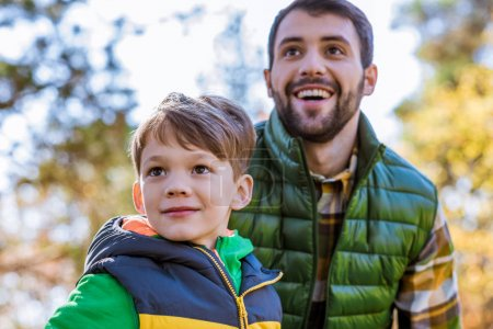 Happy father and son in park