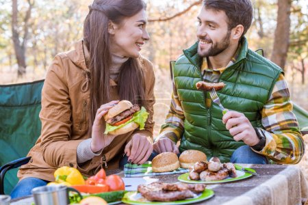Smiling young couple on picnic