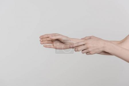 Photo for Cropped view of tender female hands, isolated on grey - Royalty Free Image