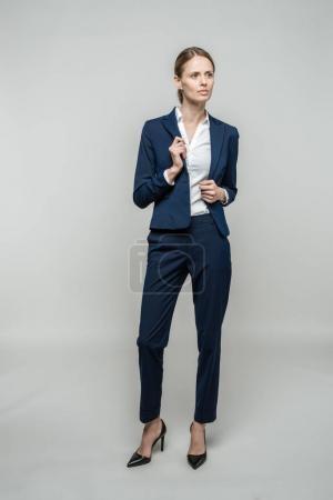 confident businesswoman in suit
