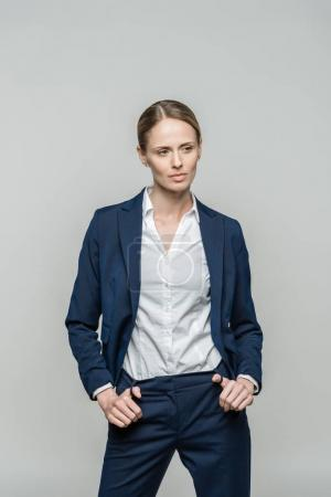 Photo for Beautiful confident businesswoman in suit, isolated on grey - Royalty Free Image