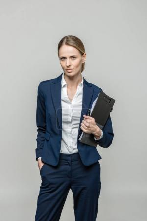 businesswoman with clipboard and documents