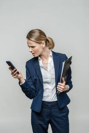 confused businesswoman with smartphone