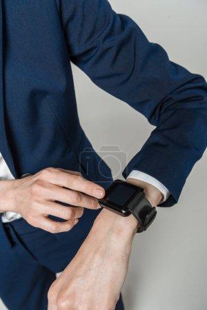 Businesswoman using smart watch