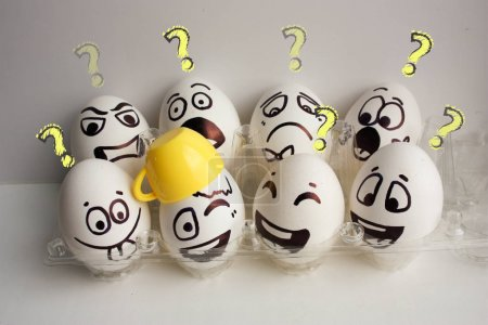 Photo for Eggs face. A cheerful egg company with eight pieces with a mug on the head. Photo for your design. Question concept. - Royalty Free Image