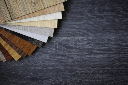 Photo for Laminated wooden sample.A studio photo of  laminate flooring accessories. Repair, building and home concept. Interior and Architectural choose outside corner part of laminate. - Royalty Free Image