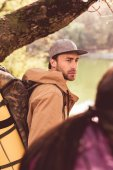 Young bearded man traveler with backpack
