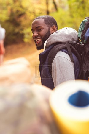 Young smiling man backpacker
