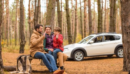 Happy family in autumn forest